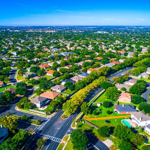 Growing suburban town Round Rock , Texas , USA aerial drone view high above Suburb Neighborhood with Vast amount of Homes